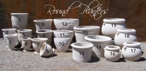Range of round cement planters